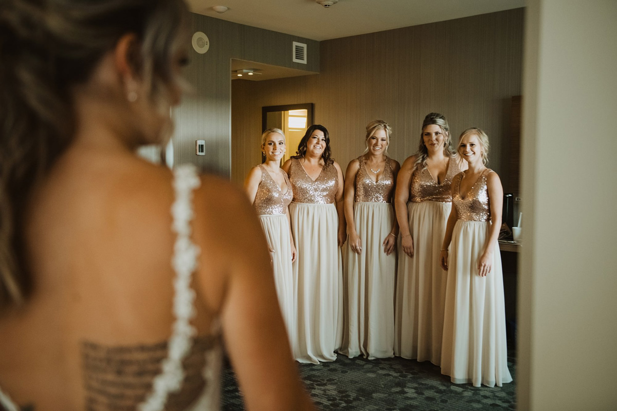 first look with bride and bridesmaids at hyatt regency calgary