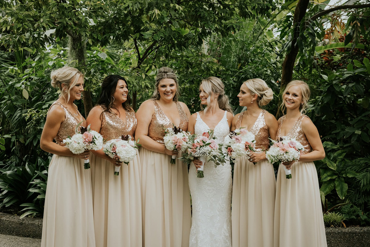 bridesmaids at indoor garden in calgary zoo wedding