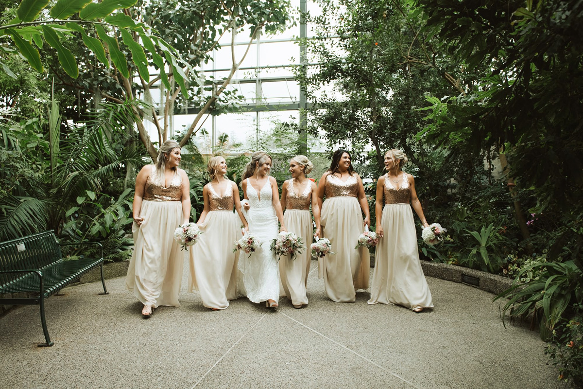 bridesmaids walking indoor gardens at calgary zoo