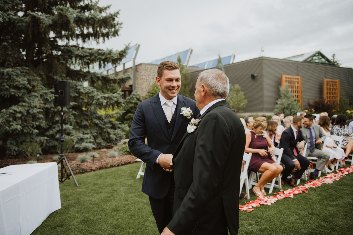 groom entering outdoor wedding ceremony