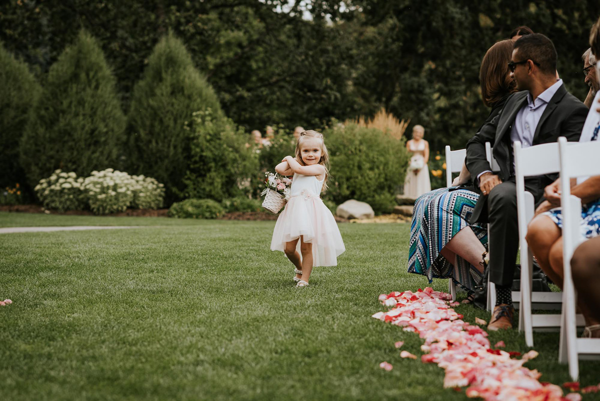 flowergirl walking down the isle to outdoor ceremony at calgary zoo
