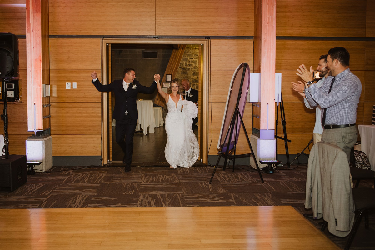 bride and groom enter wedding reception