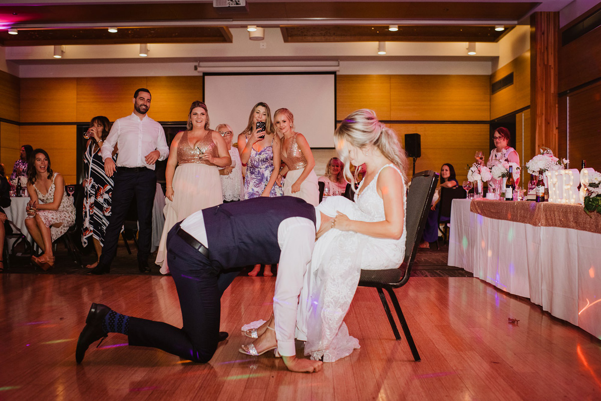 garter toss at calgary zoo wedding reception