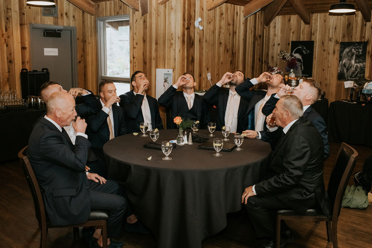 groomsmen drinking shots before wedding ceremony