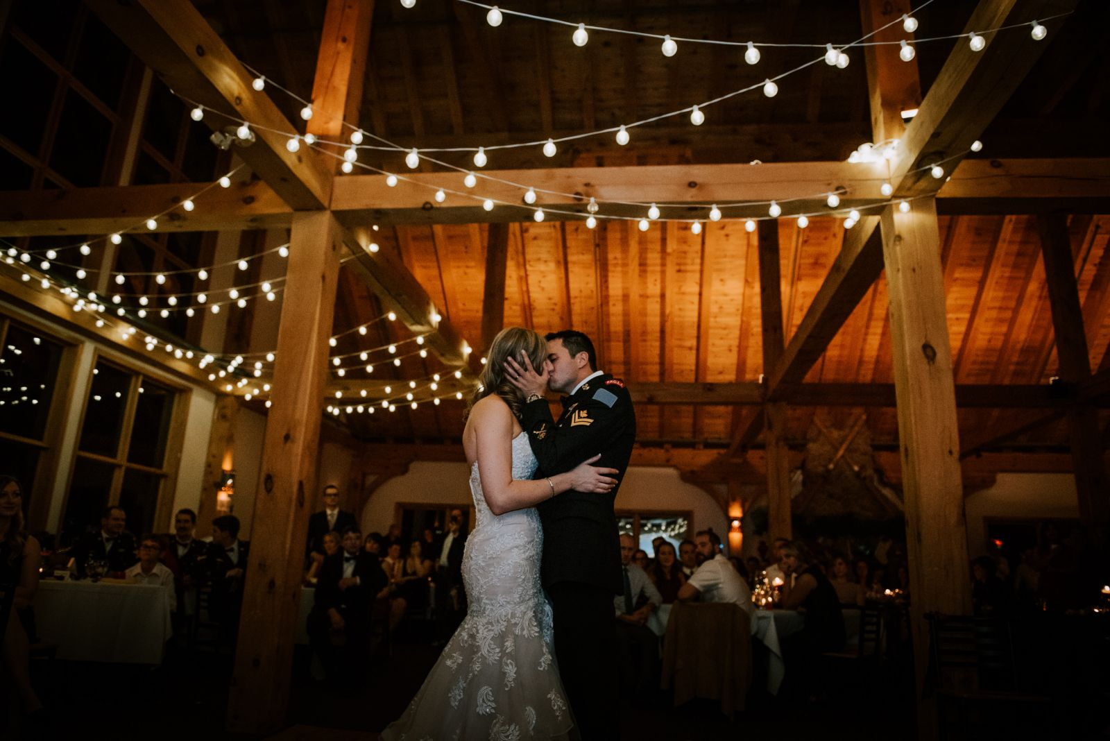 bride and groom sharing first dance and first kiss