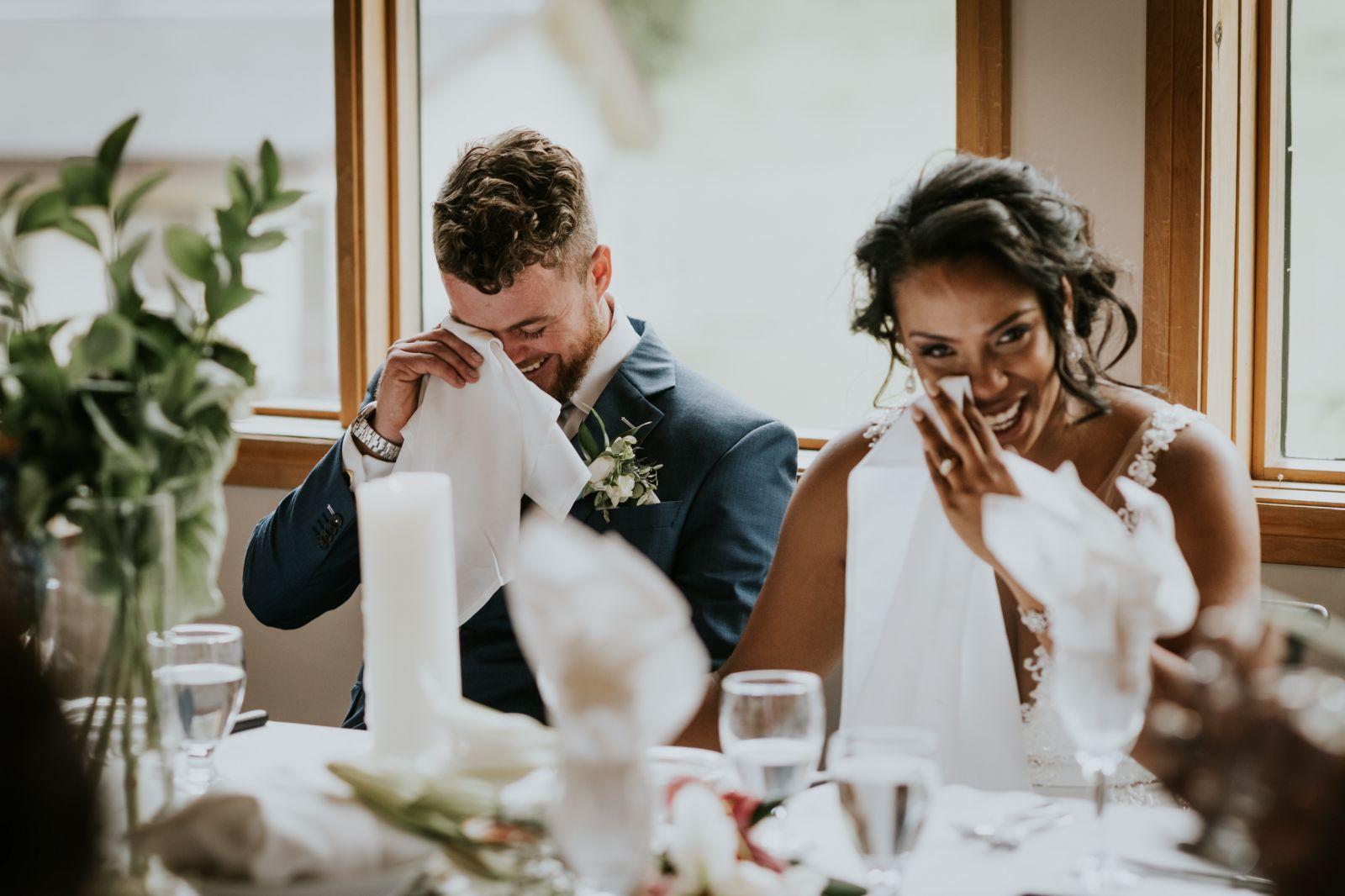 bride and groom wiping tears emotional speech