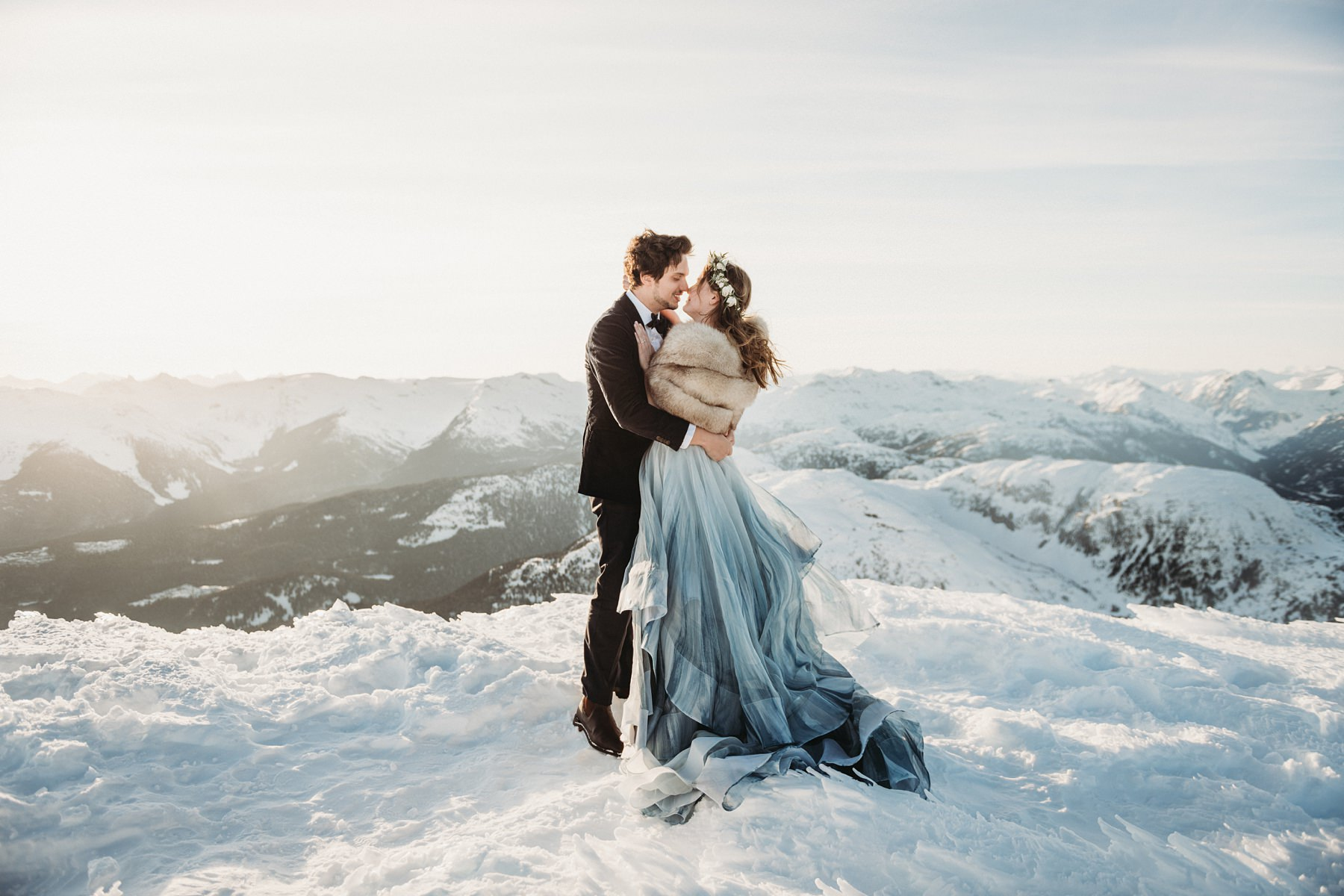 bride and groom on mountains in winter in whistler heli wedding