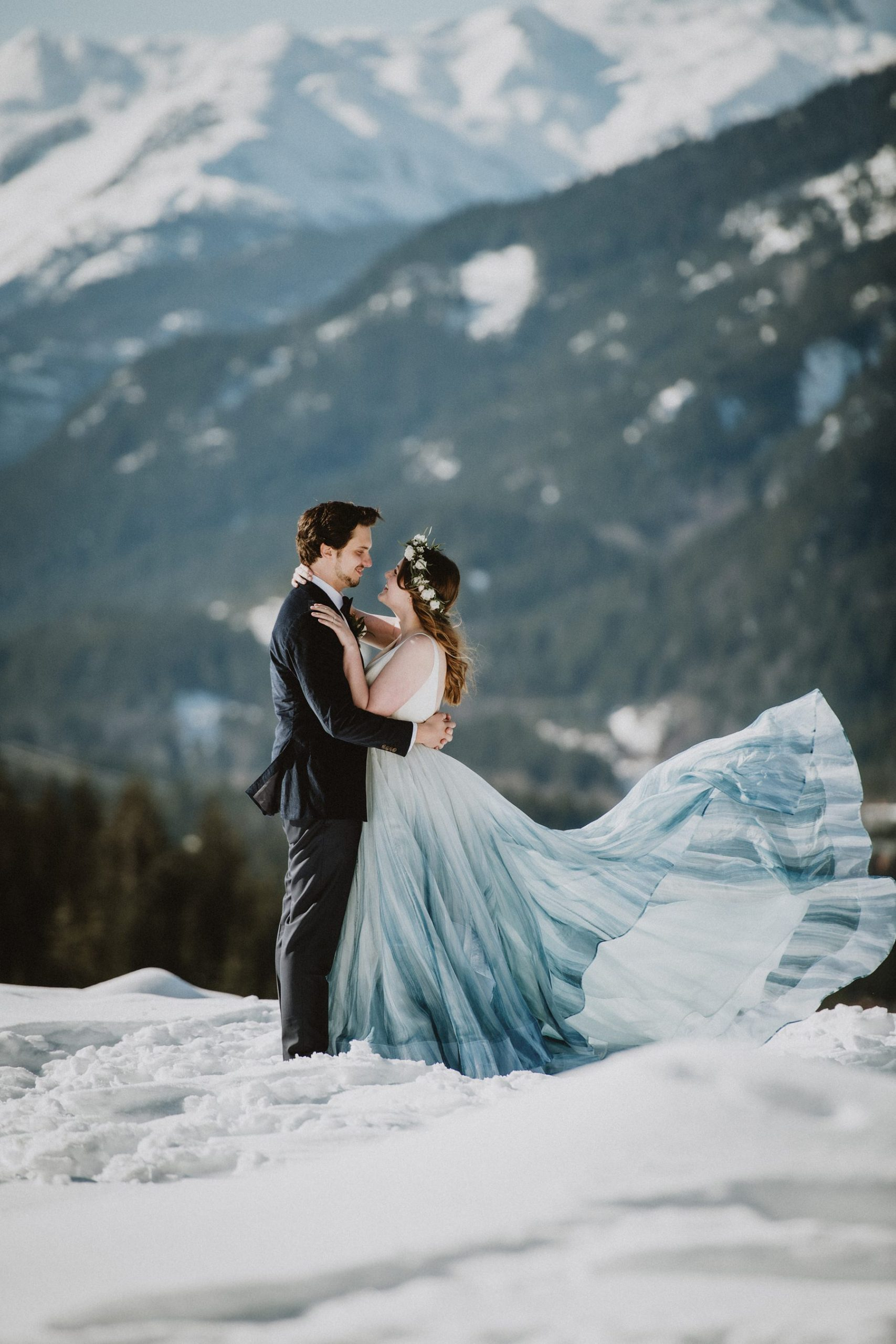 bride and groom in winter in mountains