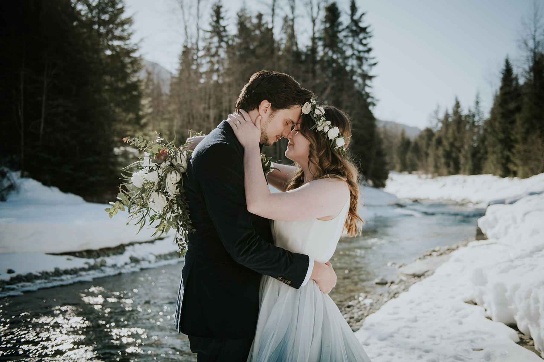 bride and groom river in winter Nita lake lodge wedding