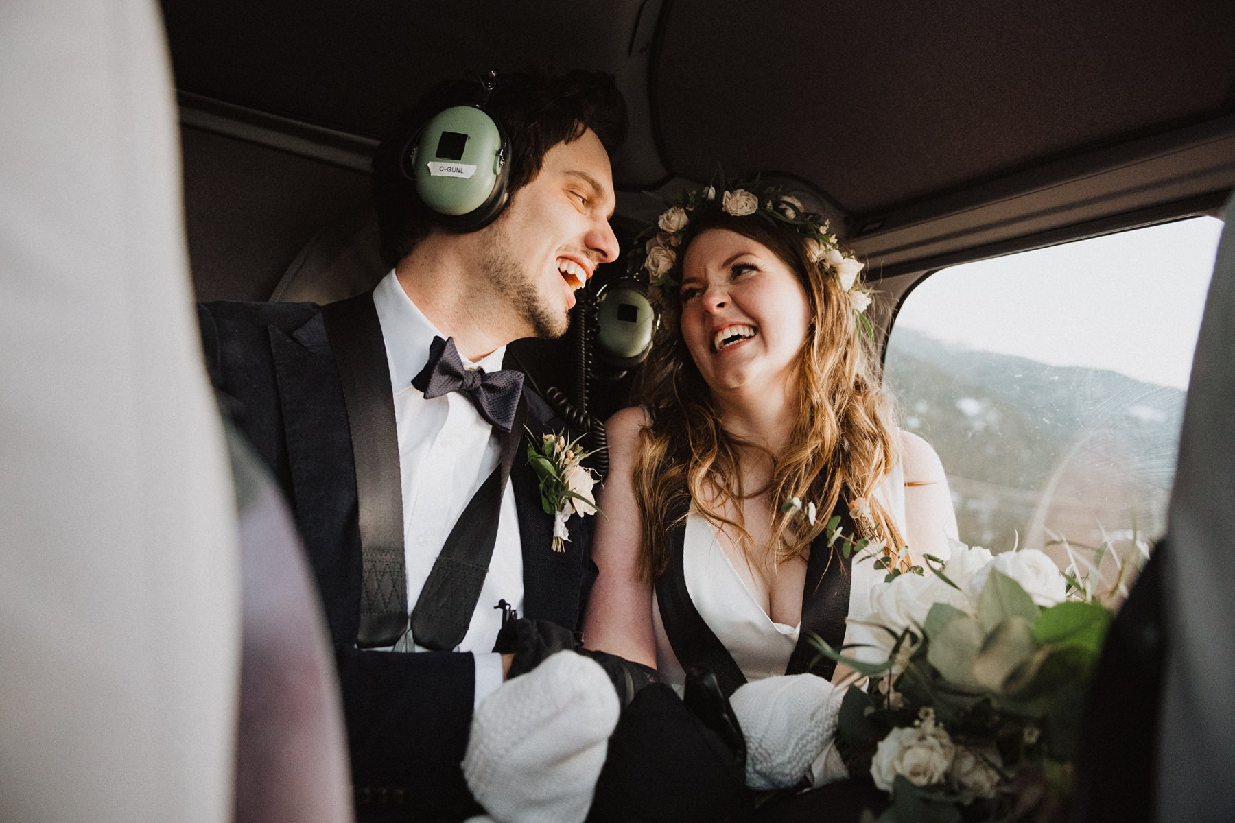 bride and groom in helicopter at whistler wedding