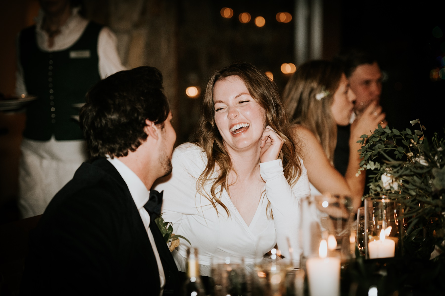 bride and groom laughing during speeches at wedding reception Nita lake lodge