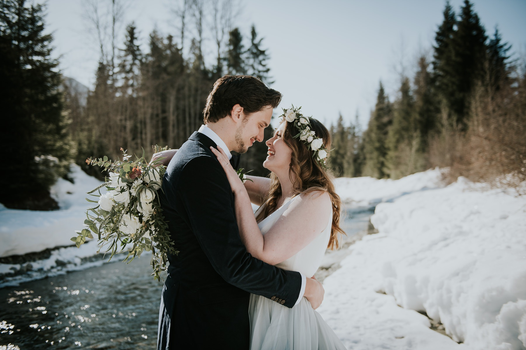 bride and groom laughing winter forest