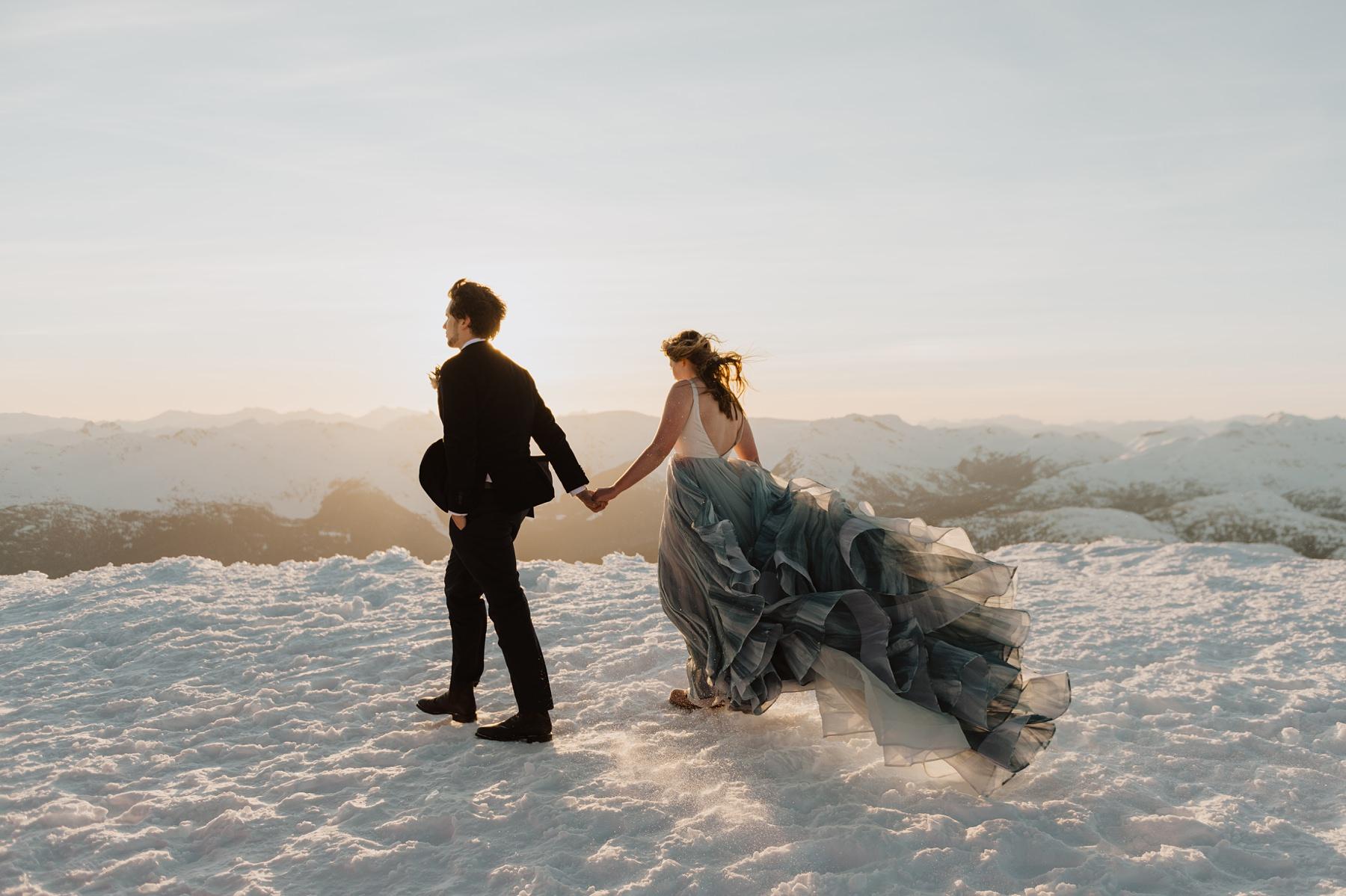 bride and groom walking in the snow during winter wedding at Nita lake lodge