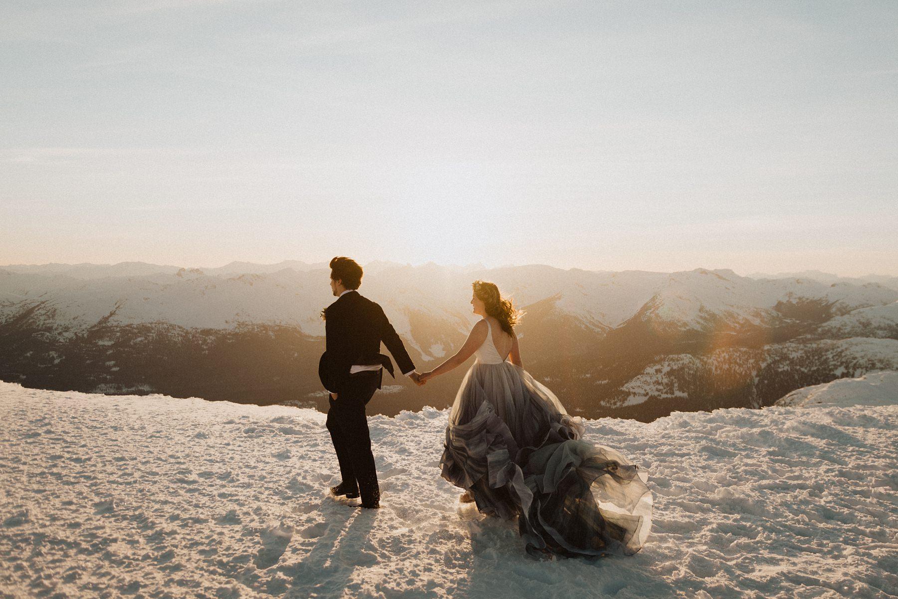 bride and groom walking on mountains at Nita lake lodge wedding