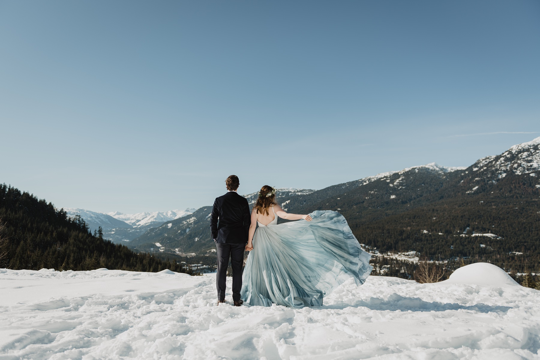 colourful wedding dress in the snow in mountains