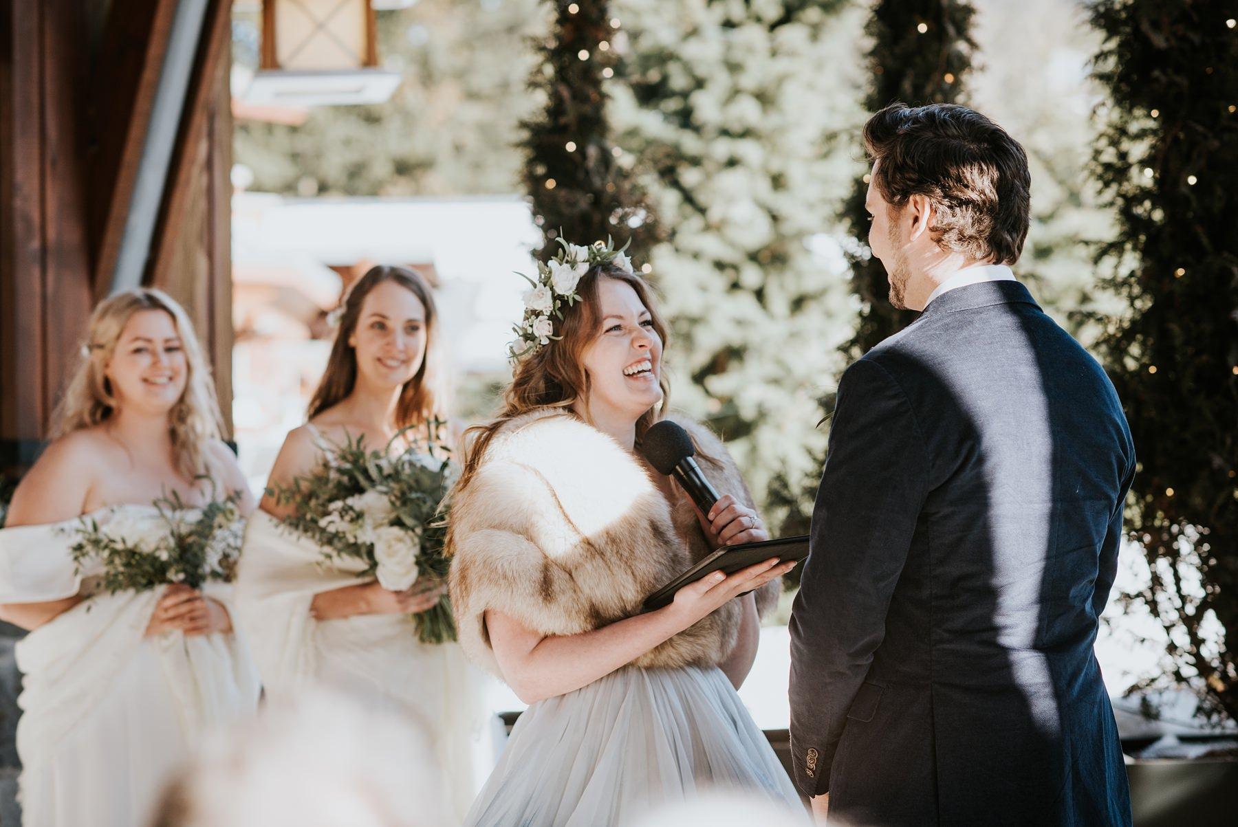 bride laughing during vows at Nita lake lodge wedding ceremony