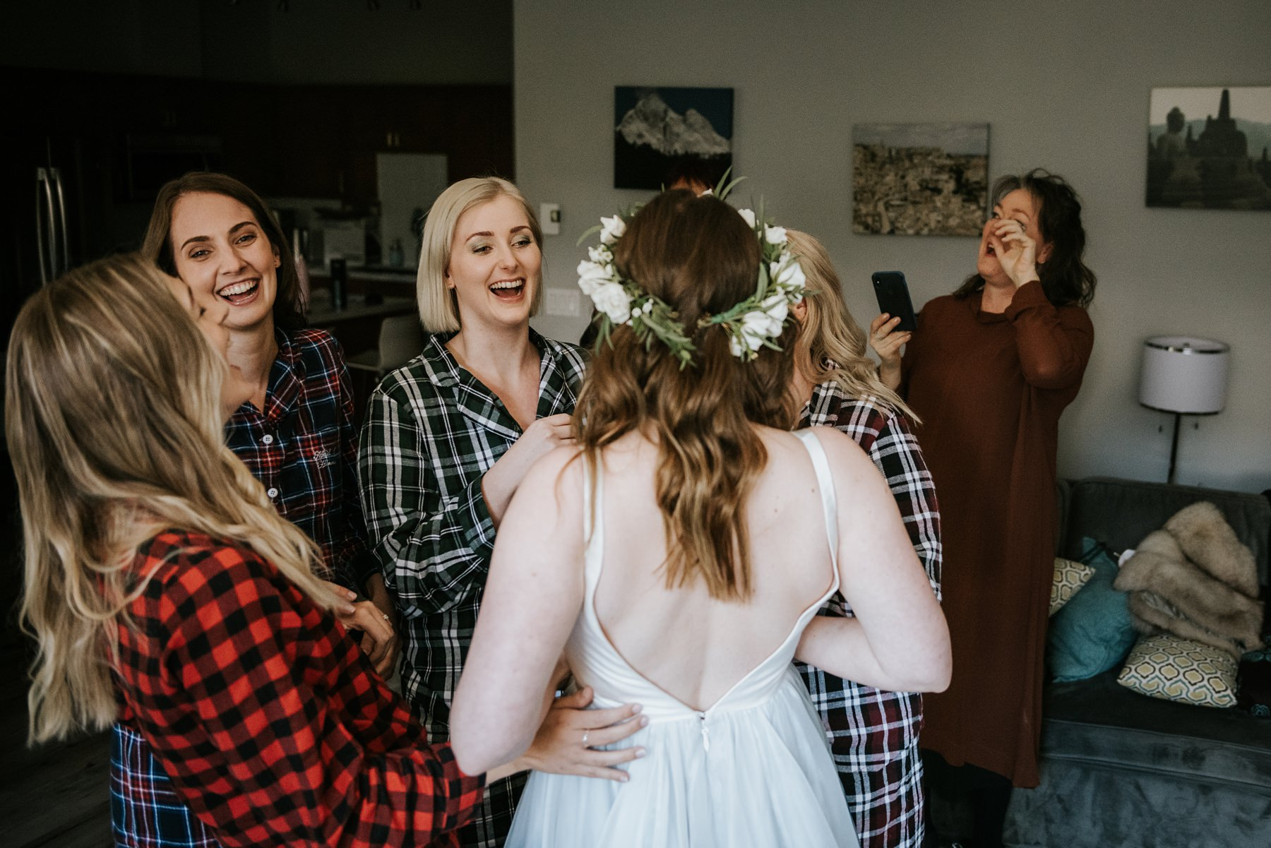 bridesmaids laughing with bride at chateau fairmont whistler