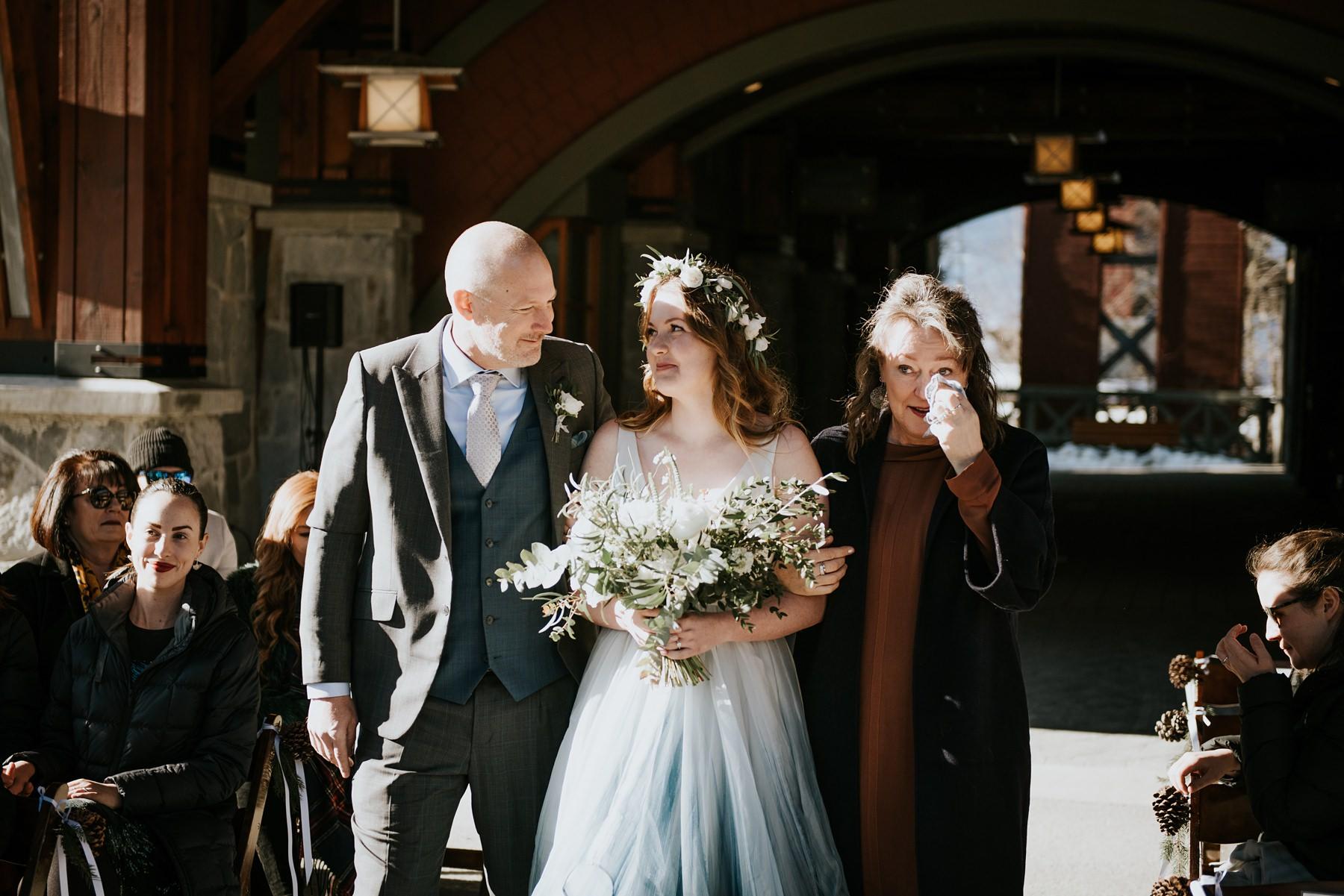 bride and parents walking to ceremony at Nita lake lodge