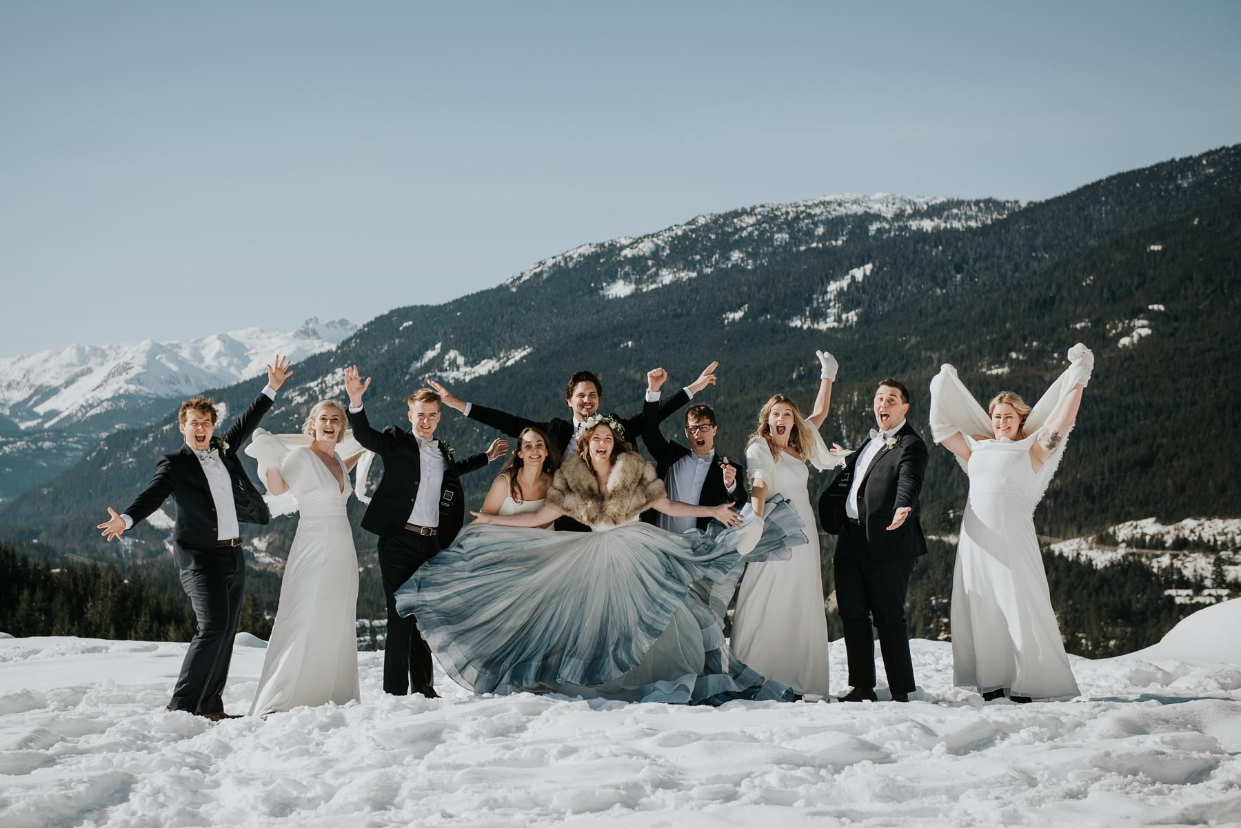 bridal party having fun in winter at Nita lake lodge wedding