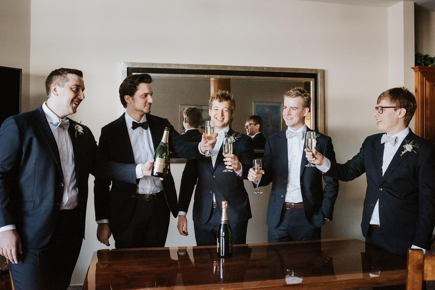 groomsmen toast with groom before wedding ceremony