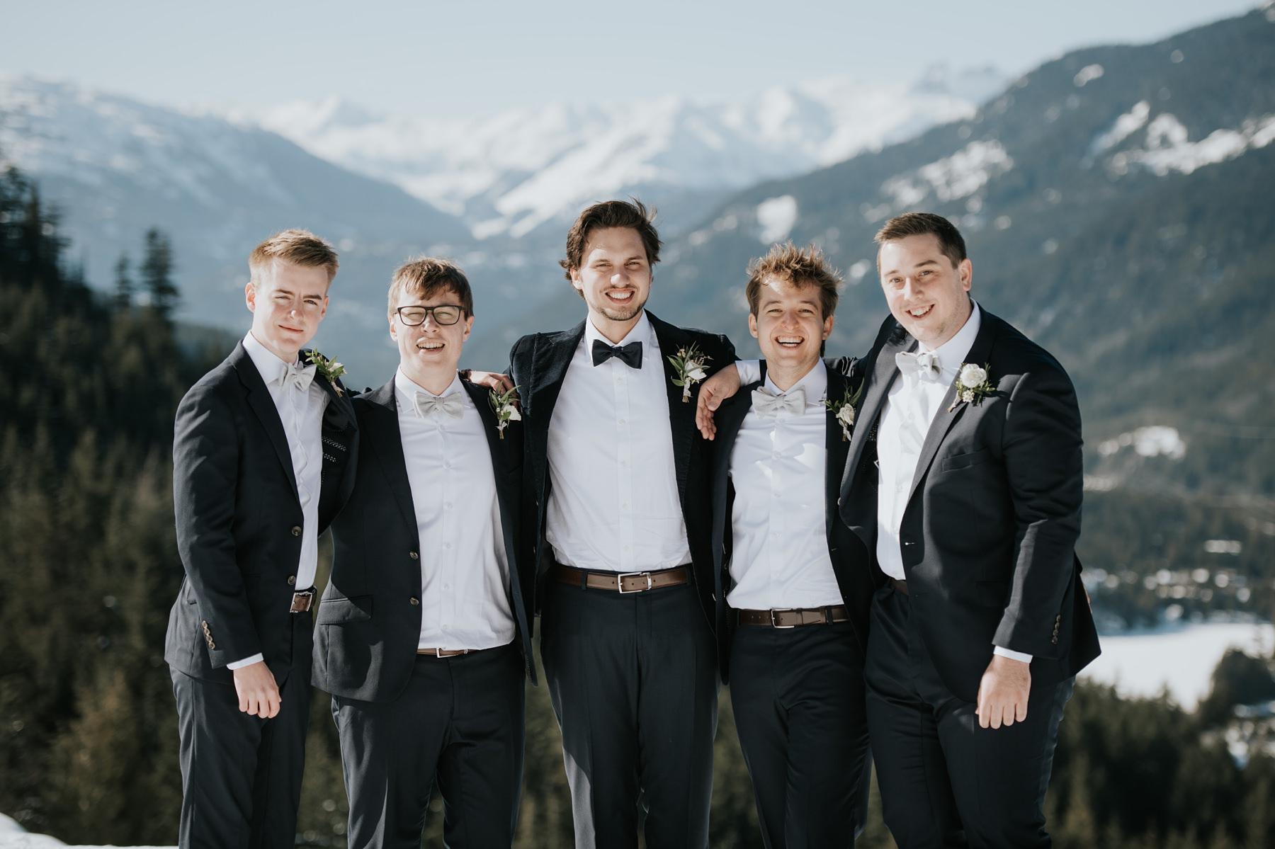 groom and groomsmen in mountain wedding
