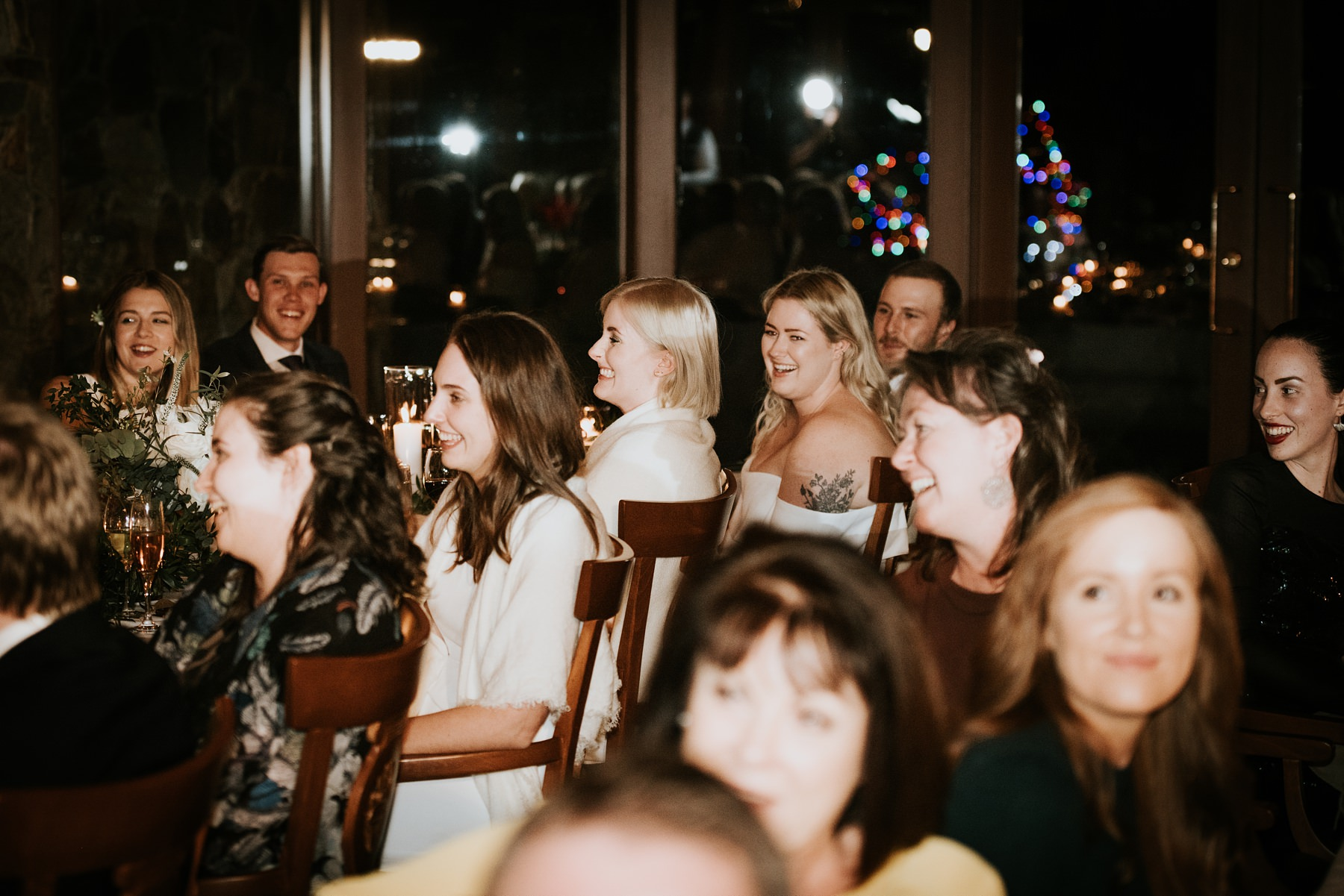 wedding guests laughing at speeches indoor wedding venue whistler