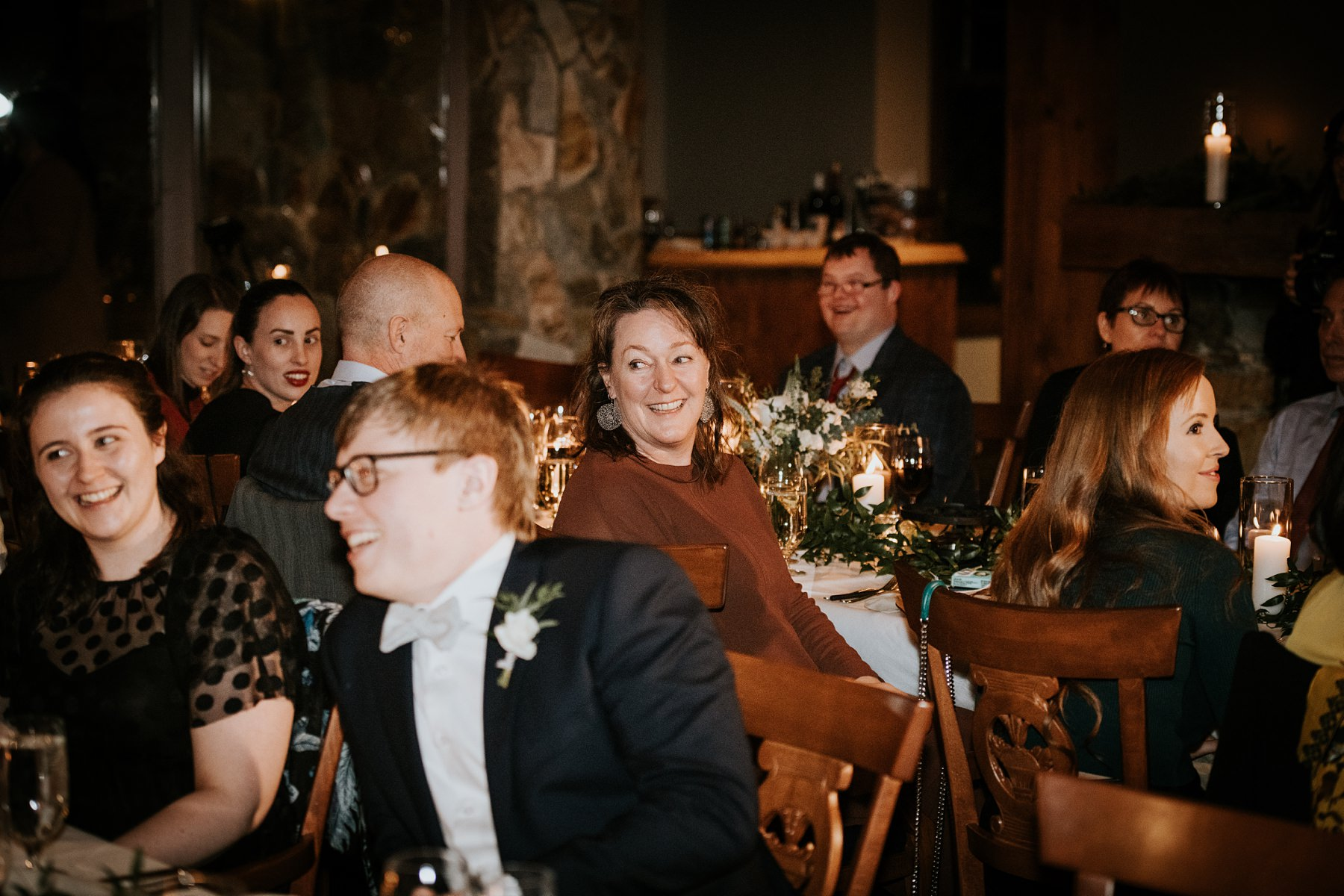 wedding guests laughing at wedding reception