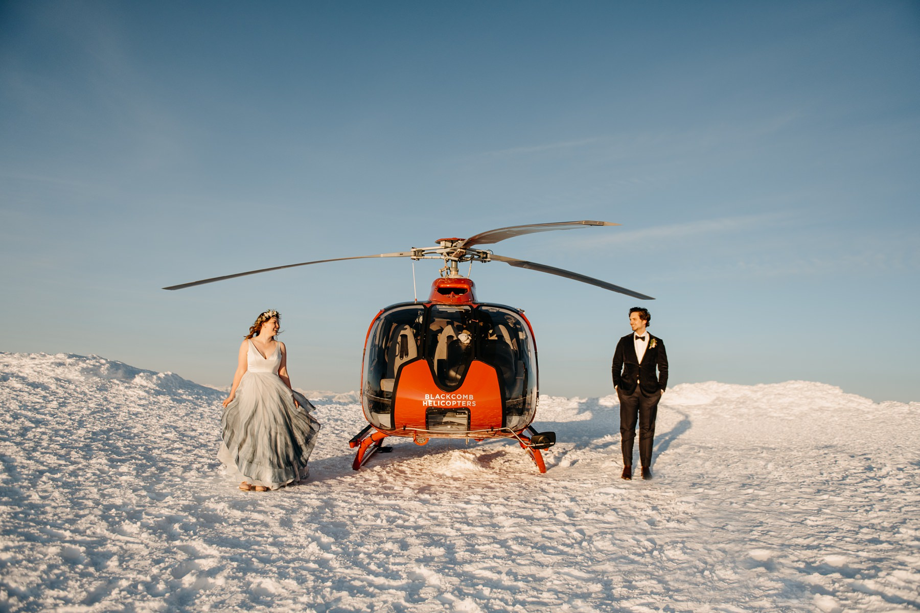 bride and groom with helicopter during wedding