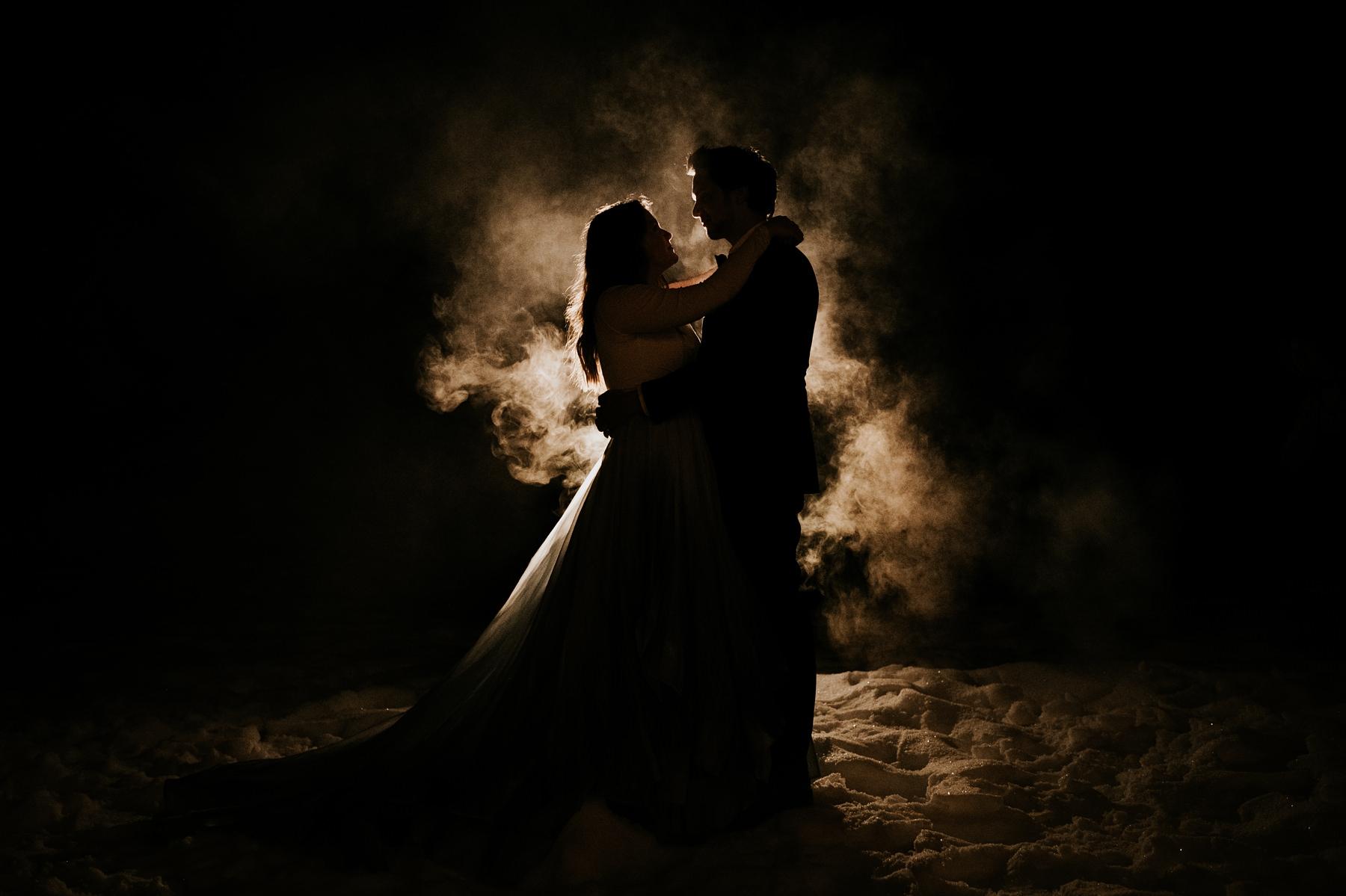 bride and groom in atmosphere night photo