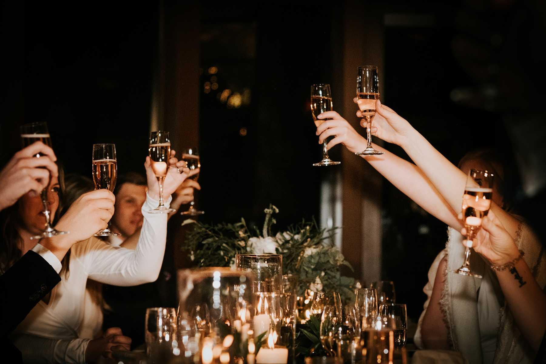 wedding guests toasting at the fairmont chalet wedding reception