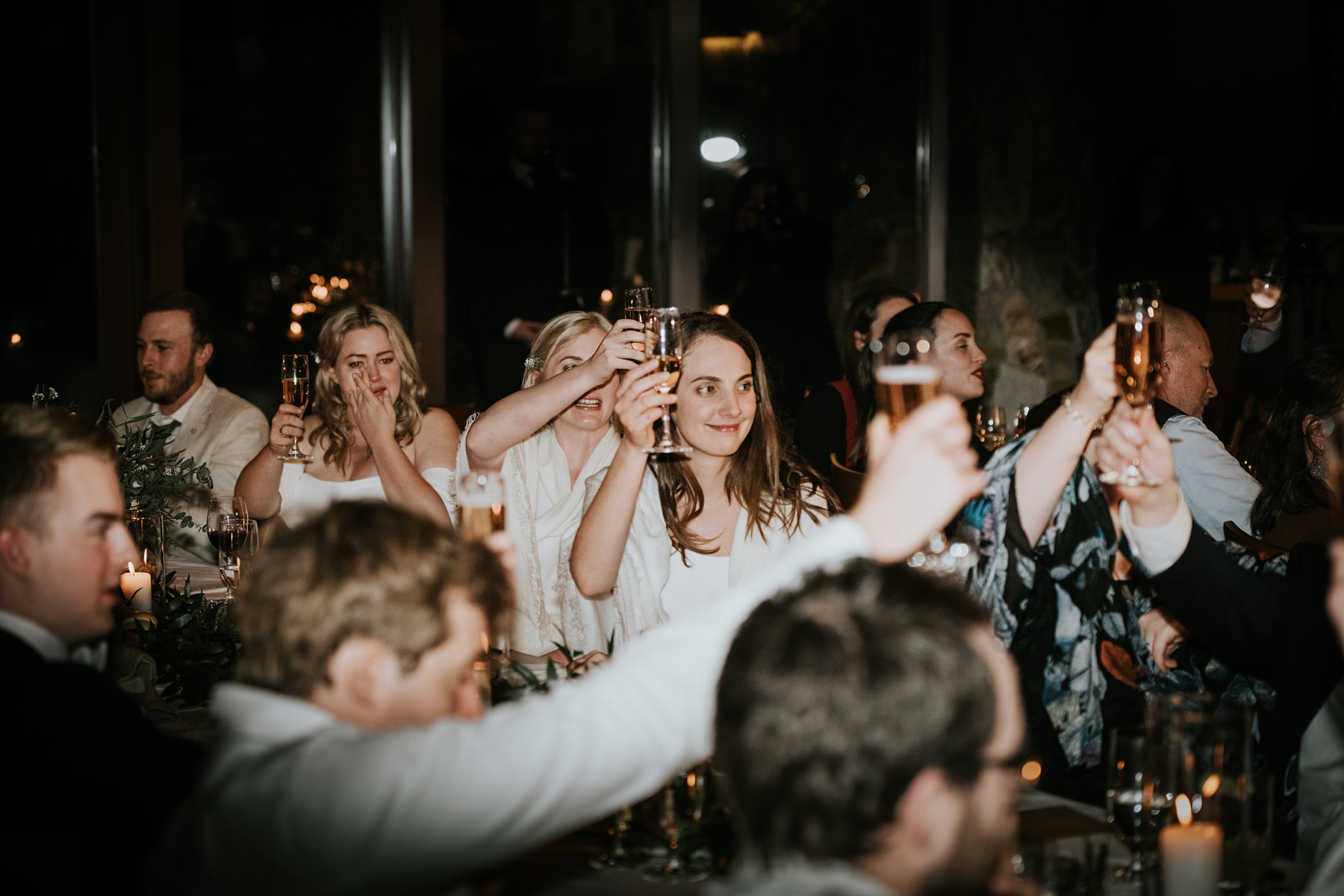 guests toasting bride and groom during wedding reception
