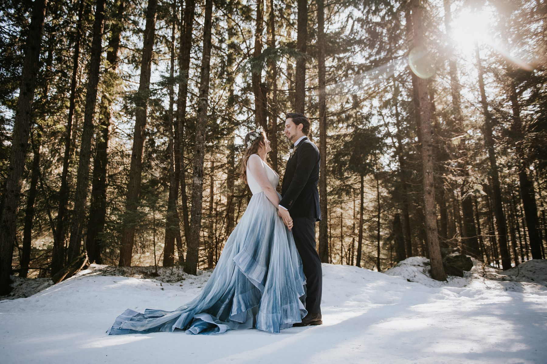 bride and groom in forest in snow